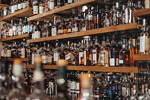 Image of a bar shelf full of alcohol, demonstrating the temptation involved in going sober for a month